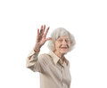 Happy elder lady waving isolated against white background with copyspace Stock Image