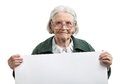 Happy elderly lady holding blank sheet in hand over white Royalty Free Stock Images