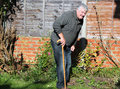 Happy elderly man with walking stick. Stock Photography