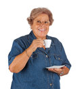Happy elderly woman drinking coffee on white background Stock Photo