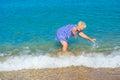Happy elderly woman enjoying on the beach Royalty Free Stock Photo