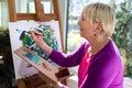 Happy Elderly Woman Painting F...