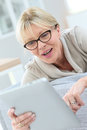 Happy elderly woman using tablet Royalty Free Stock Photo