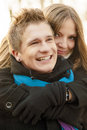 Happy embraces close up portrait of young caucasian couple having fun together and embracing Stock Photo