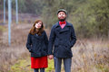 Happy engaged couple portrait of a to be married in the winter outdoors this is modern trendy hipster and fashion first Royalty Free Stock Images