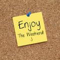 Happy enjoy the weekend note message on bulletin board Royalty Free Stock Photos