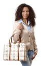Happy ethnic woman holding handbag Stock Photography
