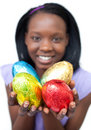 Happy ethnic woman showing Easter eggs Royalty Free Stock Image