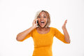 Happy excited african american woman talking on mobile phone Royalty Free Stock Photo