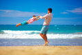 Happy excited father and son having fun on summer beach enjoy life playing together Royalty Free Stock Image