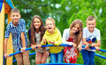 Happy excited kids having fun together on playground children Royalty Free Stock Image