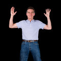 Happy excited man hands raised in air middle age black background Stock Photo