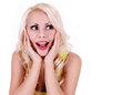 Happy excited woman looking up and screaming cheerful beautiful blonde young woman isolated on white Royalty Free Stock Photo