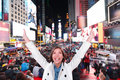 Happy excited woman in new york times square city manhattan cheering celebrating joyful at night with arms raised smiling cheerful Stock Photography