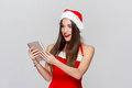 Happy excited woman in snowflakes holding tablet christmas Royalty Free Stock Images