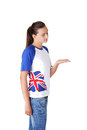 Happy excited young woman in tshirt with british flag showing copy space isolated on white Royalty Free Stock Photos