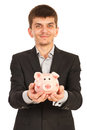 Happy executive man with piggy bank holding isolated on white background Stock Photo