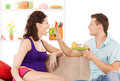 Happy expecting parents at home pregnancy and healthy eating concept Royalty Free Stock Photography