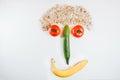 Happy face made with fresh fruits. Tomato, cucumber , banana, pu Royalty Free Stock Photo