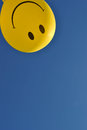 Happy face yellow round against clear blue sky background Royalty Free Stock Images