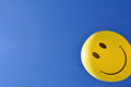 Happy face yellow round against clear blue sky background Stock Image