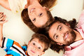 Happy faces family lying on the floor head to head father mother and son isolated over white Stock Images