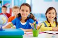 Happy faces portrait of school children drawing with crayons Stock Photography