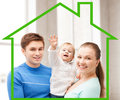 Happy family with adorable baby home happiness and real estate concept smiling Stock Photo