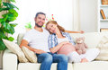 Happy family in anticipation of the birth of baby. Pregnant woma Royalty Free Stock Photo