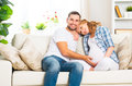 Happy family in anticipation of the birth of baby pregnant woma women and her husband on sofa at home Stock Photo