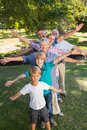 Happy family with arms outstretched in the park on a sunny day Stock Photography