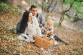 Happy family in an autumn forest Royalty Free Stock Photo