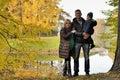 Happy family in autumn park near lake Royalty Free Stock Photo