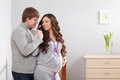 Happy family awaiting baby couple indoor shoot Royalty Free Stock Photos