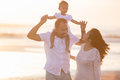 stock image of  Happy family and baby enjoying sunset in the summer leisure