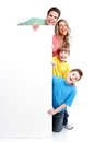 Happy family with banner. Royalty Free Stock Photo