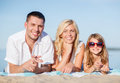 Happy family on the beach Stock Photos