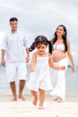 Happy family beach enjoying their vacations Stock Images