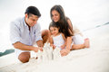 Family making sand castles Royalty Free Stock Photo