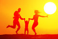 Happy family on the beach silhouette of jumping at sunset Royalty Free Stock Photos