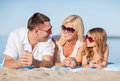 Happy family on the beach summer holidays children and people concept Stock Image