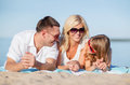 Happy family on the beach summer holidays children and people concept Royalty Free Stock Photos