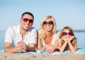 Happy family on the beach summer holidays children and people concept Stock Photography