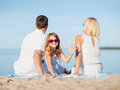 Happy family on the beach summer holidays children and people concept Stock Photos