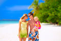 Happy family on the beach of three having tropical vacation maldives Stock Image