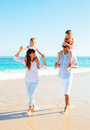 Happy family on the beach walking Royalty Free Stock Photos