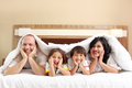Happy family in the bed Royalty Free Stock Photos