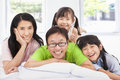 Happy family on the bed asian Royalty Free Stock Photos