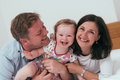 Happy family in bed Royalty Free Stock Photo