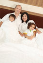 Happy family in the bedroom Stock Photo
